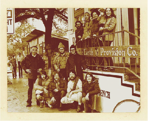 Original whole earth staff standing outside our original location in Austin
